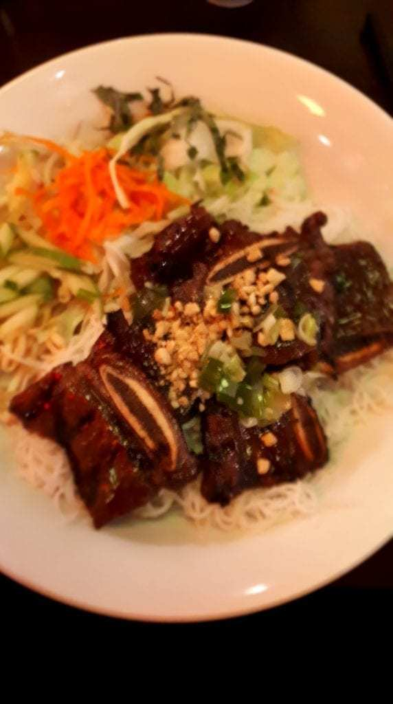 BBQ Short Ribs, served on a bed of rice.