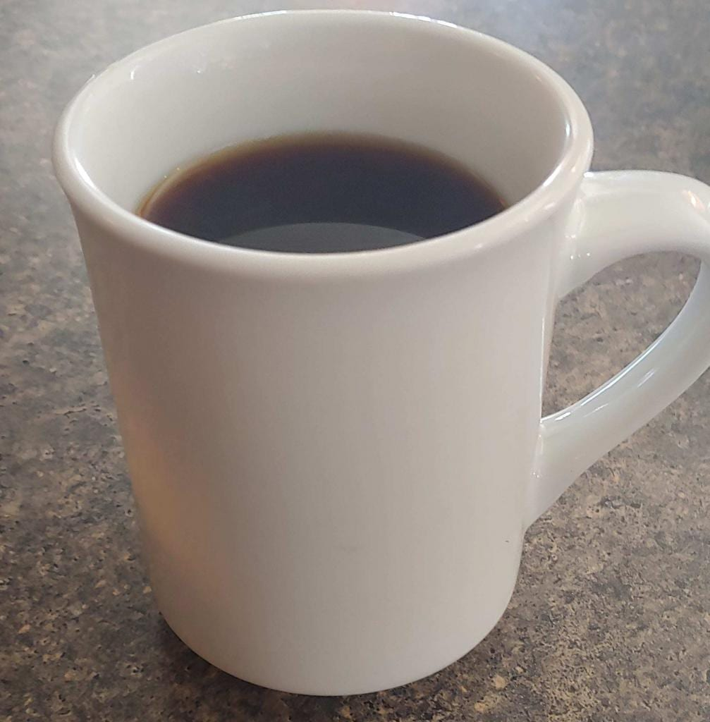 A bottomless cup of coffee to go with my breakfast.